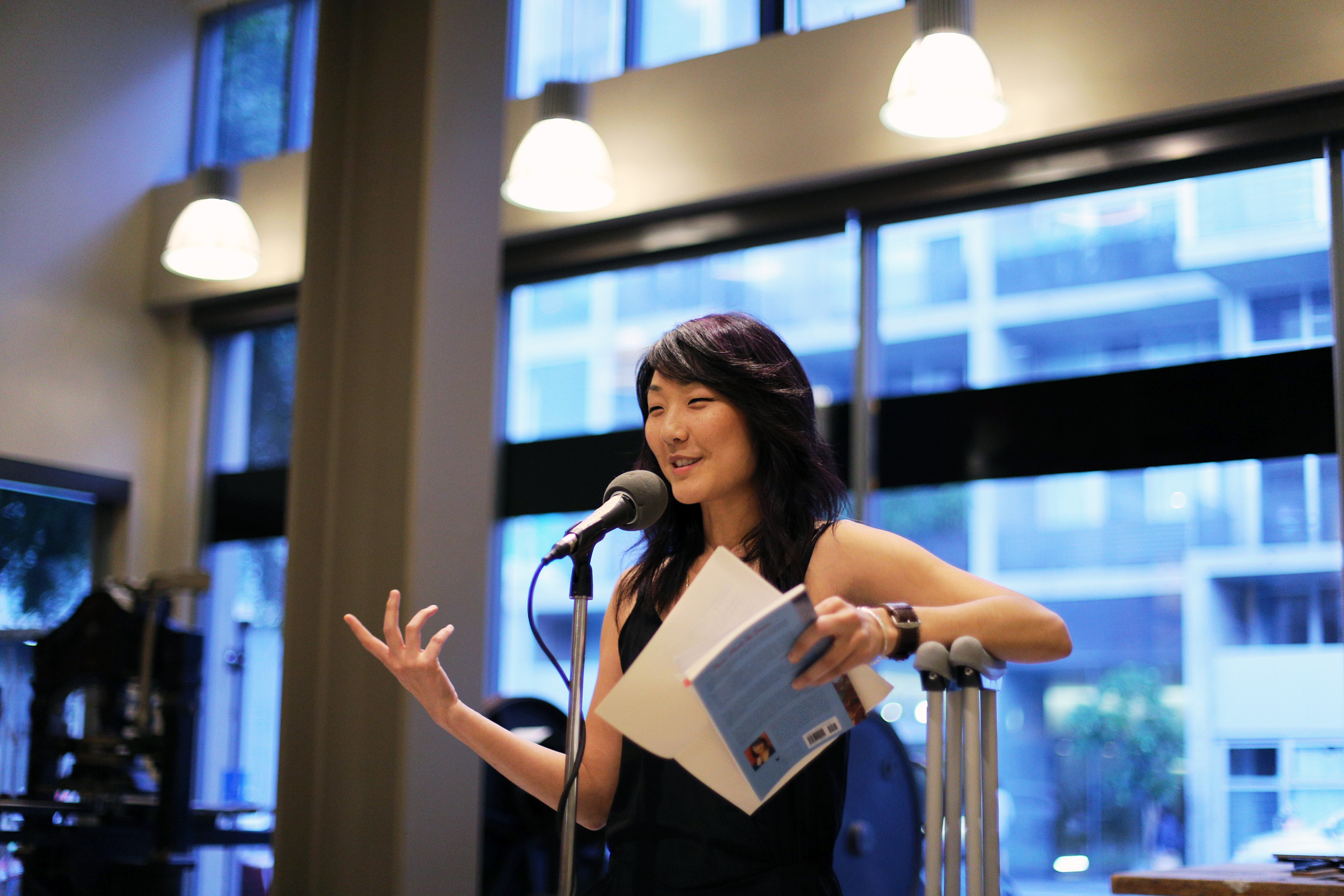 Grace under fire. Brynn Saito reads at the American Bookbinders Museum despite an injured hip