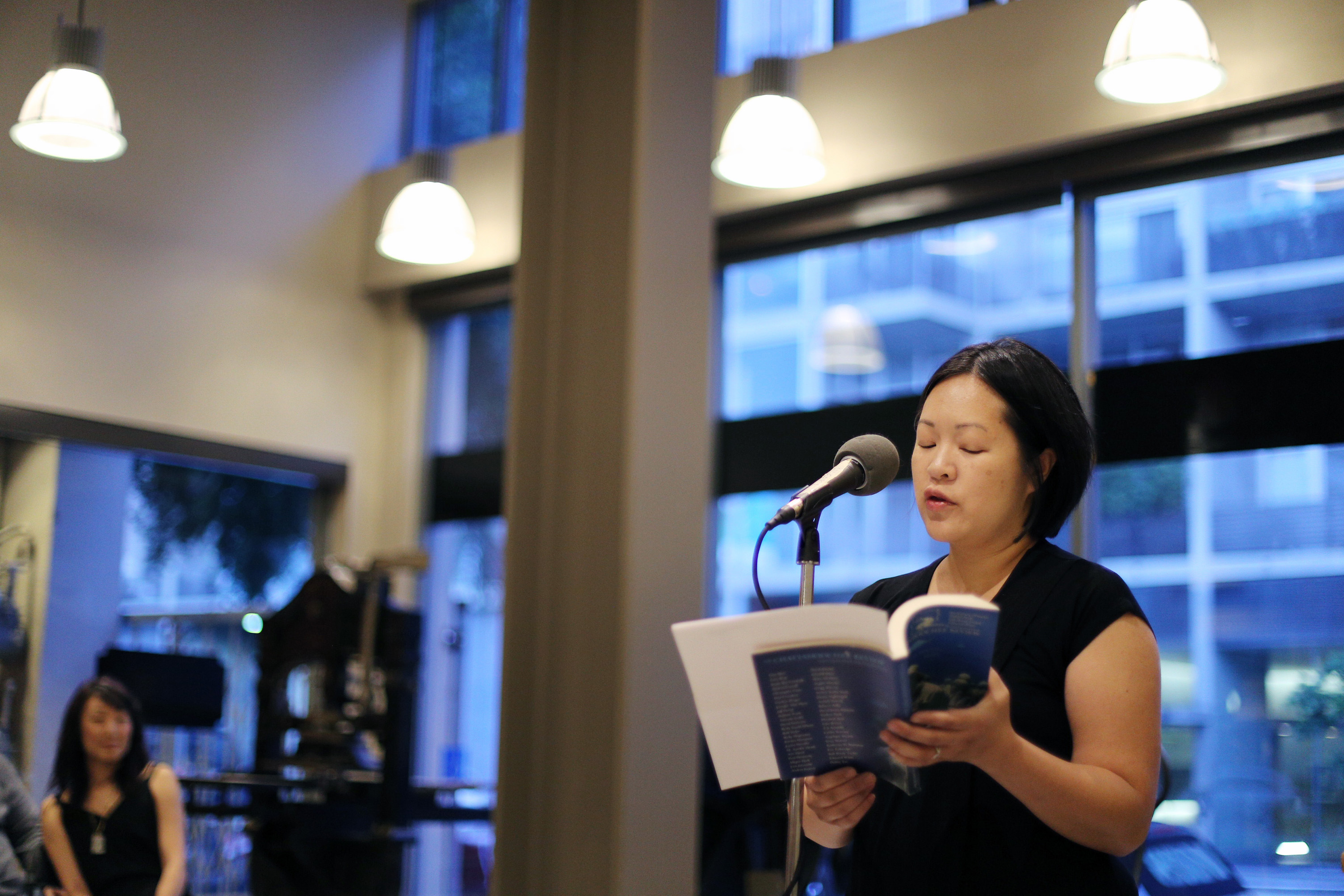 Debbie Yee reads at the American Bookbinders Museum after meditating on the image of the body as book.