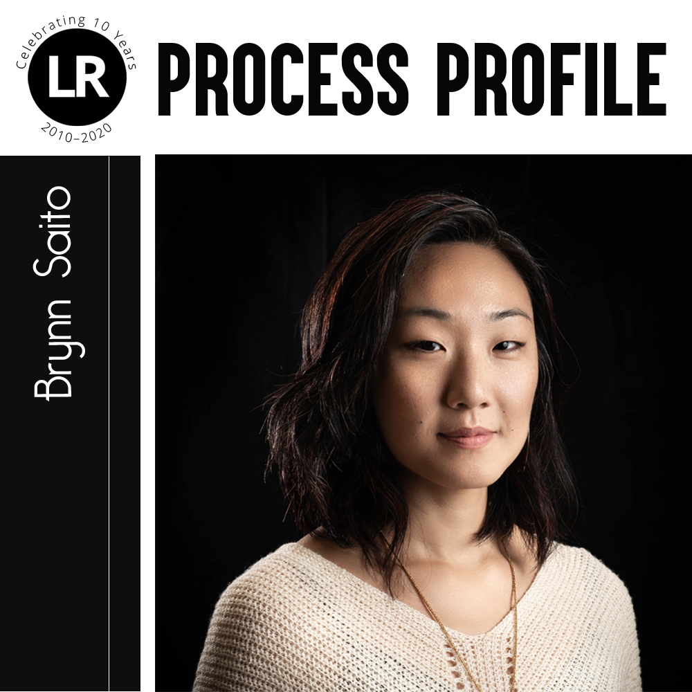 LR: Celebrating 10 Years, 2010–2020; Process Profile: Brynn Saito. Photograph of Brynn Saito (Asian American poet with shoulder-length hair standing at a 3/4 angle against a black background)