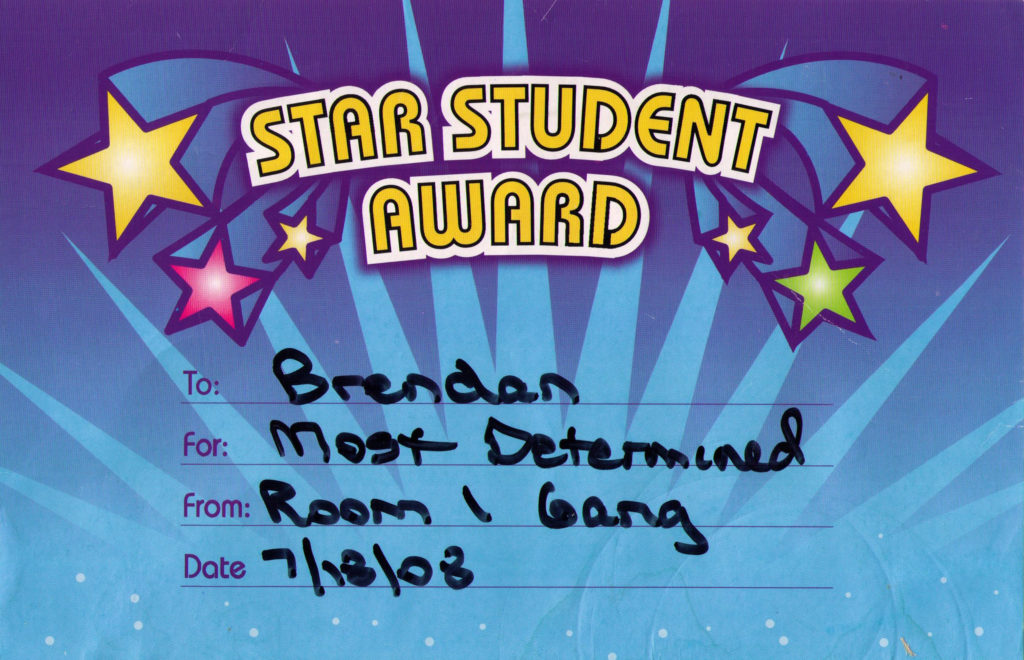 """Blue award certificate featuring colorful stars and the words, """"Star Student Award. To: Brendan. For: Most Determined. From: Room 1 Gang. Date 7/18/08"""""""